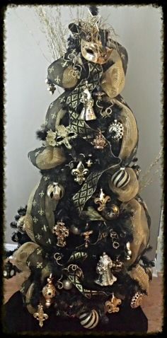 My New Orleans Saints Tree for the office looks similar-but I use gold mardi gras beads instead of ribbon