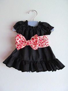Baby Black and White Polka Dot Ruffle Dress with Red Floral Bow Sash 0-3 Months. $42.00, via Etsy.