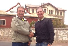 Mr Gerd Kessler of the Lüderitz 4x4 Club, handing over the donation to Piet Swiegers of the Namibia Wild Horses Foundation.