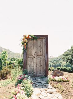 Unique Wedding Door. Connected to the outdoors with a little touch of flowers in the frame. Perfect backdrop for an outdoor rustic wedding!