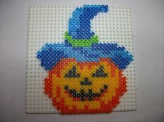 Halloween pumpkin hama perler by Halloween Beads, Halloween Patterns, Halloween Crafts, Pearler Bead Patterns, Perler Patterns, Perler Beads Pegboard, Pixel Art, Perler Bead Mario, Motifs Perler