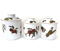 Gorgeous canister set in the Evesham Gold pattern by Royal Worcester.  These fine porcelain canisters are made in England and adorned with fruit and vegetables.  These stil... #vintage #etsy #gifts