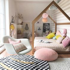 Pastel kids room, love the eames rocking chair.
