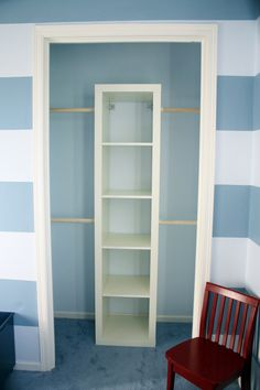 Super Cheap Small Closet Makeover. Anchor an IKEA Expedit Shelf into the wall. Use wood dowls (anchored into the wall and then screwed into the Expedit) for the new clothes rods. Two levels of clothes rods adds more space for clothes.