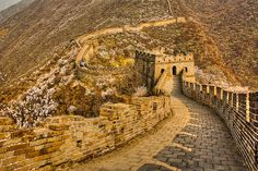 The Great Wall of China at Mutianyu. It's a little further out of Beijing than Bataling, but still manageable. Get there before the hoards of tourists if you want decent pictures.