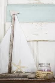Beach or summer decor- driftwood sailboat, starfish, votive wrapped in rope, pebbles