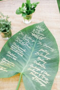 a giant leaf as the program for the ceremony | LVL Events | Brandon Kidd | Maui Montage Tropical Wedding | 25 unique wedding ideas > http://styleunveiled.com/unique-wedding-styles/