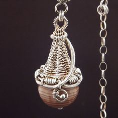 Pendant | Mary Tucker.  Sterling silver with agate....love the bassket weave! ...just might have to try that!!