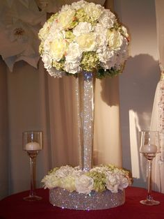 This go perfect with my wedding theme... So gorgeous! bling crystal wedding flower centerpiece
