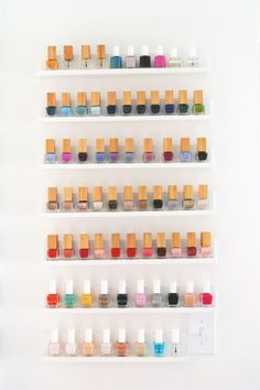"""Quick and easy custom nail polish shelves from A Beautiful Mess. """"This project not only looks cute but helps me quickly find what polish color I may be looking for. Bonus points that I never forget what colors I already own. Diy Makeup Organizer, Ikea Closet Organizer, Makeup Vanity Decor, Diy Vanity, Makeup Rooms, Ikea Organization Hacks, Business Organization, Ikea Hacks, Makeup Organization"""