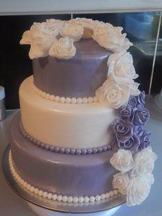 Lilac & white wedding cake with rose cascade