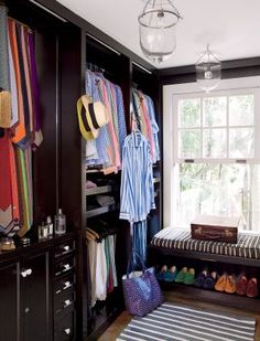The dressing room of Sig Bergamin's São Paulo home is accented with stripes (to match the many striped shirts).