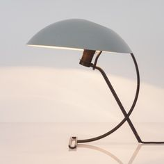 Located using retrostart.com > NB100 Desk Lamp by Louis Kalff for Philips