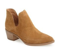 This Steven Madden booties comes in black leather or this camel suede for $129.