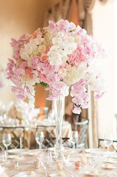 Floral Centerpieces to die for!! Large Orchid Centerpieces. Pink and White Florals. Photos by Katelyn James Photography