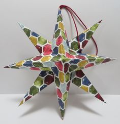 And another Stampin' Up Christmas Star made by Lynn Gauthier.  I used the new SU Cherry Cobbler Bakers Twine on page 158 of the SU Annual Catalog for the hanger.  There's some new Silver and Gold coming in the new Autumn Holiday Catalog!!!!!