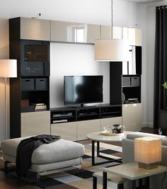 Kick back, relax and enjoy your favorite TV show or a movie night! The IKEA BESTÅ system is a neat & stylish way to organize your entertainment system.