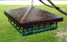 Suet feeder made from a deck post cap found at Menards.