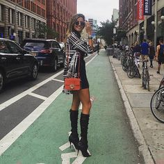 Martha Graeff wearing the Jimmy Choo ANNELI boots and carrying the REBEL bag at #NYFW {Regram: @marthagraeff}