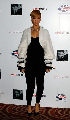 Pin for Later: A Tribute to Rihanna's Killer Street Style on Her 28th Birthday  During a 2009 London photocall, Rihanna softened her slick black jumpsuit with a plush Chanel cardigan, featuring over-the-top cuff detailing.