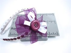 Headbands are not just for little girls they are great for all ages and hair styles. Try this Button Headband with a Mini Bowdabra Bow