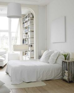 White cozy bedroom with reclaimed wood accent and baby's crib. Let's swing. hm?