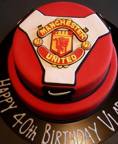 Manchester United Cake. I would do this as Liverpool for my husbands birthday!