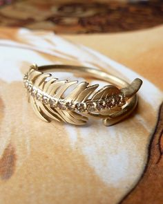 Champagne Diamond Feather Ring by kateszabone on Etsy https://www.etsy.com/listing/95941153/champagne-diamond-feather-ring