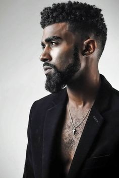 Curls with a fade to beard...good look