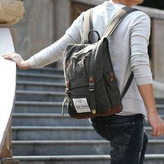 """The laptop backpack crafted with military green cotton canvas and detailed with suede leather, the laptop backpack is designed to hold an most 14"""" laptops, and personal items. Ideal for school, travel, camping, hiking or works.  Features:  Encryption cotton canvas body and suede bottom. Flap..."""