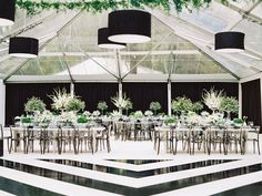 real wedding photo planned by evoke design and creative black and white theme modern minimalism style black and white dance floor and modern seating reception