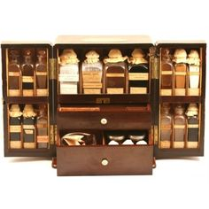Apothecary Chest Young Collection Phisick Medical Antiques ❤ liked on Polyvore featuring harry potter, fillers, hogwarts, home, medical and backgrounds