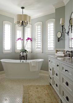 Restful retreat from BRADSHAW DESIGNS in beautiful San Antonio Texas, master bath, scallop light, hexagon travertine floor tile, Photographer-Jennifer Siu-Rivera