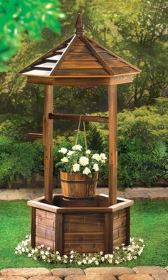 Buy Rustic Wishing Well Planter at wholesale prices. We offer a large selection of cheap Wholesale Garden Planters. If you need Rustic Wishing Well Planter in bulk at a discount price then buy from WholesaleMart. Diy Garden, Garden Planters, Garden Projects, Garden Art, Garden Pool, Outdoor Wood Projects, Potager Garden, Porch Garden, Night Garden
