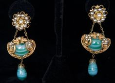"HASKELL BAROQUE EAR CLIPS, 1940-1950  -  Marbled turquoise glass stone & drop w/ pearl accents set in brass filigree setting, Miriam Haskell stamped in oval under clasp, L 3"", excellent. From Estate of fashion historian & designer Charles Kliebacker."