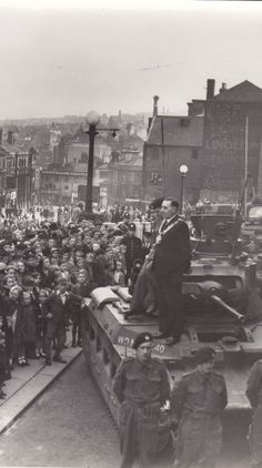 A tank parked outside the town hall, during World War II. Photo © Barnsley Museums