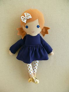 Custom listing for Chelsea:    This is a handmade cloth doll measuring 20 inches. She is wearing a sweet navy blue dress with long sleeves, white and