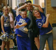 Angie Petty, right, cheer coach for the Centerville Junior High cheerleaders, dances with Colton Beck, during a volleyball game at the Centerville school Wednesday, Sept. 26, 2012.  The squad has four cheerleaders with special needs, including Colton, and the school has rallied around the kids. (Steve Griffin | The Salt Lake Tribune)