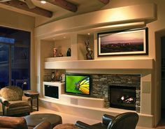 Curve Custom Media Wall Design With Natural Stone Accents