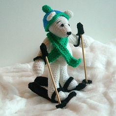 This is a Crochet Pattern including: a polar bear, skies ski sticks, a hat and a scarf.