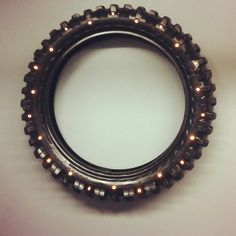 this is a great idea. Nix the lights and put a mirror behind and old tire. too cute over the fire place.