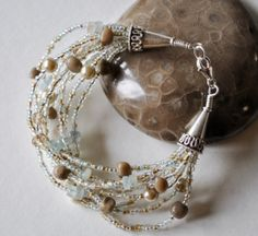9 Strand Petoskey Stone and Aquamarine Bracelet with by Beechtree, $50.00
