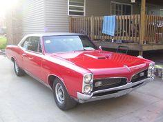 My High School car - 1967 Pontiac GTO  ( This exact color - Montero Red w/ Black, Vinyl Hardtop )