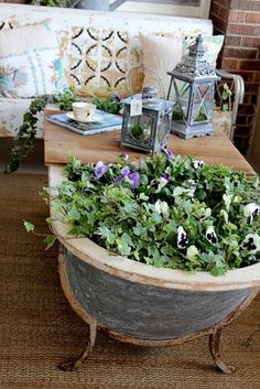 Itsy Bits and Pieces: A Visit to the Bachman's Spring 2011 Ideas House.OLD BATHTUB with board for coffee table Garden Bathtub, Old Bathtub, Cast Iron Bathtub, Bathtub Decor, Garden Pond, Bathtub Ideas, Recycled Decor, Repurposed, Mold In Bathroom