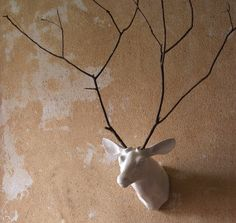 add a branch mounted wall sculpture