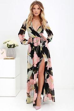 Take a moment to marvel at the sheer beauty of the Wondrous Water Lilies Black Floral Print Maxi Dress! Floral print in shades of pink, seafoam, and yellow ripples across a black chiffon backdrop as it shapes a surplice bodice framed by sheer long sleeves. A billowing maxi skirt with front slit falls below the elasticized waist for a stunning finish.