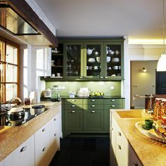 Another view of kitchen in belgian style house. Part of cabinets is designed to looks like kitchen cupboard. LEICHT kitchen by GORDON DESIGN