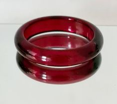 Excited to share this item from my #etsy shop: Vintage Red Moonglow Bangle, Oval Shape Red Bangle, Translucent Looking Bangle, Red Lucite Bangle.