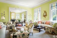 To soften the wood floor of an apple-green double drawing room in Charleston, South Carolina, designer Mario Buatta took a Stark carpet from owner Patricia Altschul's former Long Island, New York, estate and cut it in half, dividing it between the spaces   archdigest.com