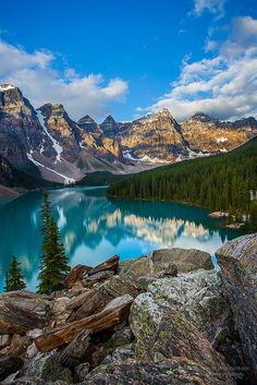 Ahhh I have been here and it's amazing! Sunrise at Moraine Lake in Banff National Park. Alberta, Canada.